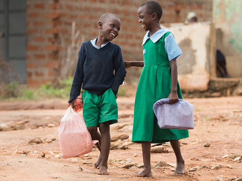 Lucia and Nzioki now have the energy to walk to school, learn and play