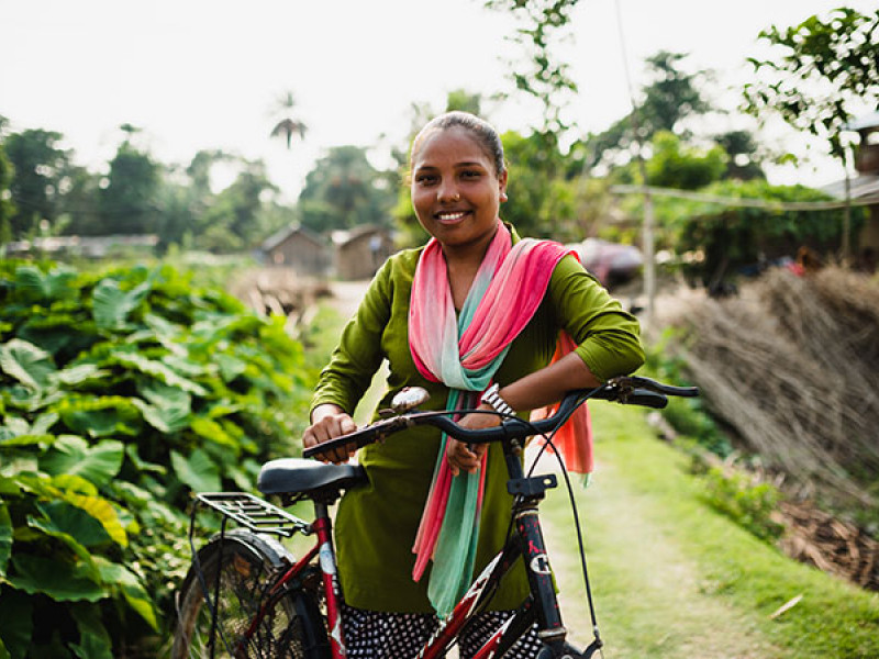 Photo of a girl with a bicycle