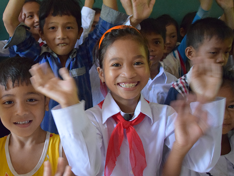 Sponsored child from Vietnam, Xinh, waves at the camera