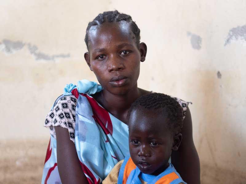 Juditha with her son Yabbah, 3, south Sudan