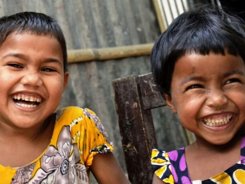 Two smiling children in Bangladesh