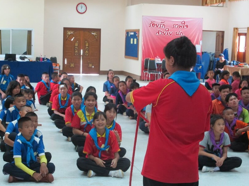 Children learning lifesaving skills at a survival camp in Thailand