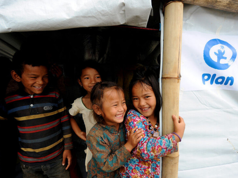 Children smiling at a child-friendly space in Nepal