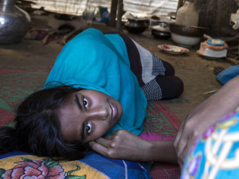 A 16-year-old girl exhausted after arriving at Balukhali camp in Bangladesh