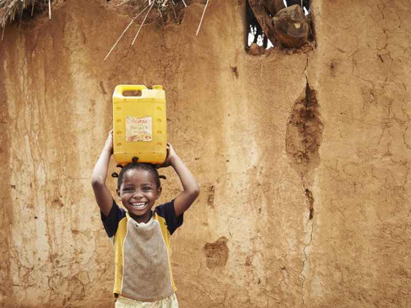 A girl carrying water home in Zambia