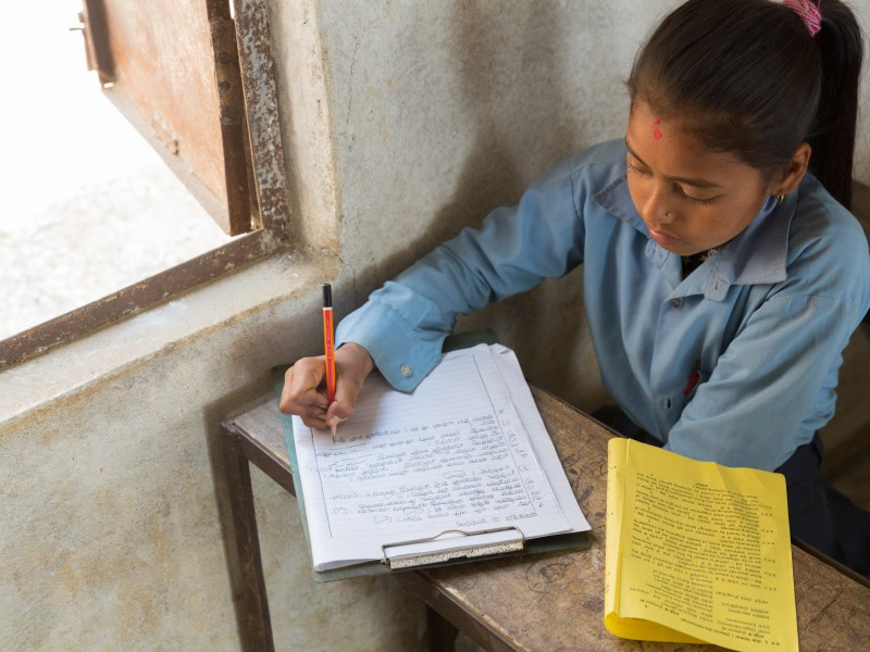 A girl learning at school in Nepal