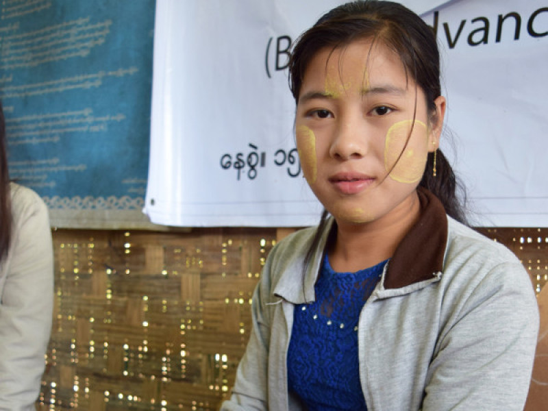 A girl learning to sew in Myanmar
