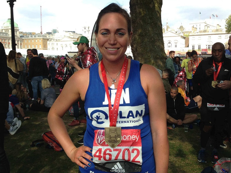 A runner with her London Marathon medal