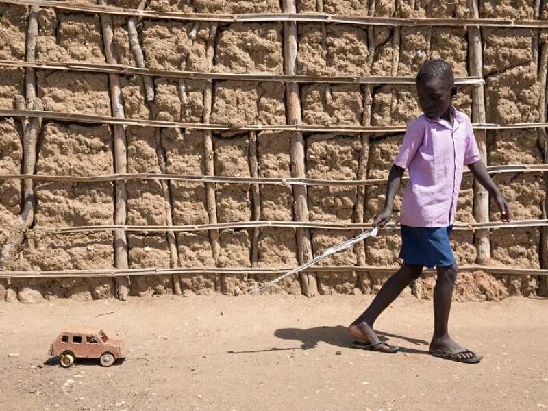 A child playing with a toy in Uganda