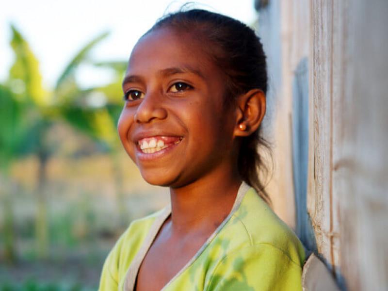 A smiling girl in Timor Leste