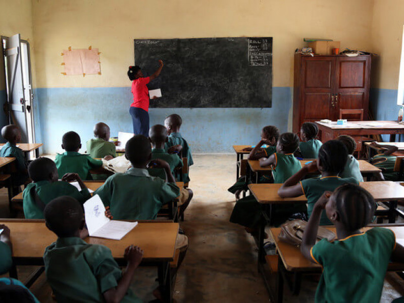 Mamie teaching a class of children in Sierra Leone
