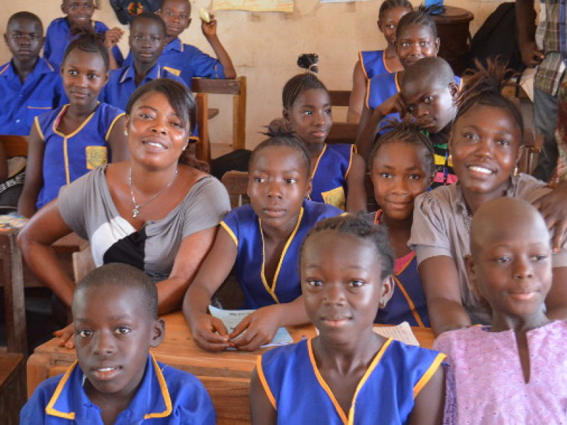 Children and their teacher at school in Sierra Leone
