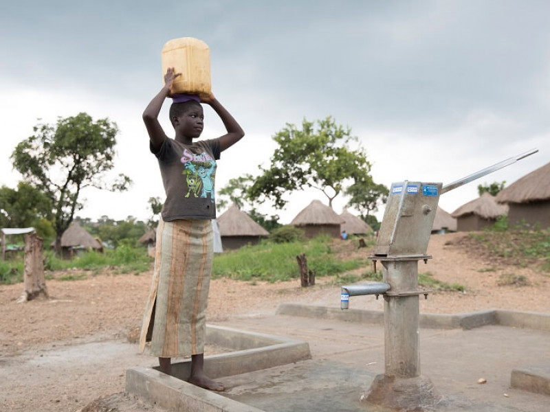 A girl collecting water in a refugee settlement in Uganda