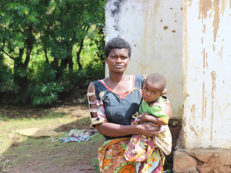 A mother and her child at a temporary shelter after the cyclone in Malawi