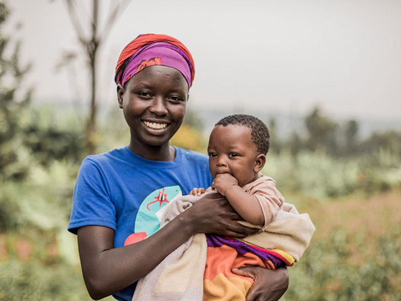Young woman holding her six month old son