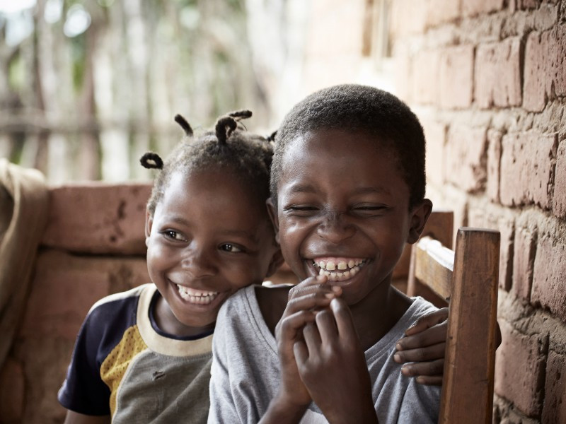 11-year-old Emma with her friend in Zambia