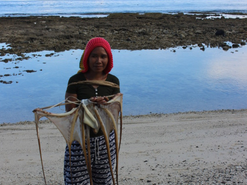 A woman holding her fishing net