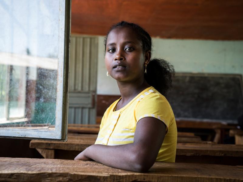 Girl sitting at a desk in a school in Ethiopia