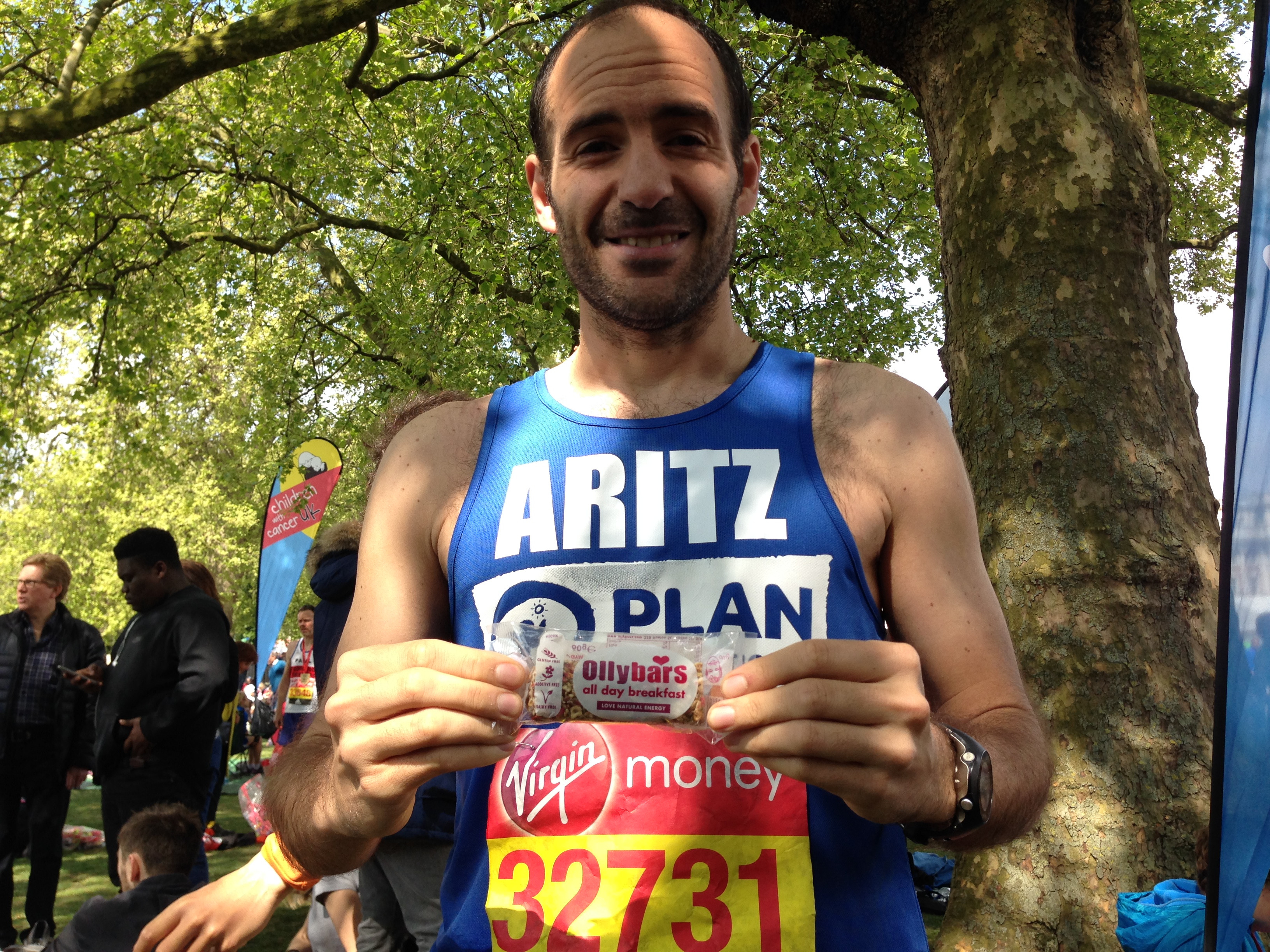 Plan runner Artiz celebrates at the finish of the London Marathon