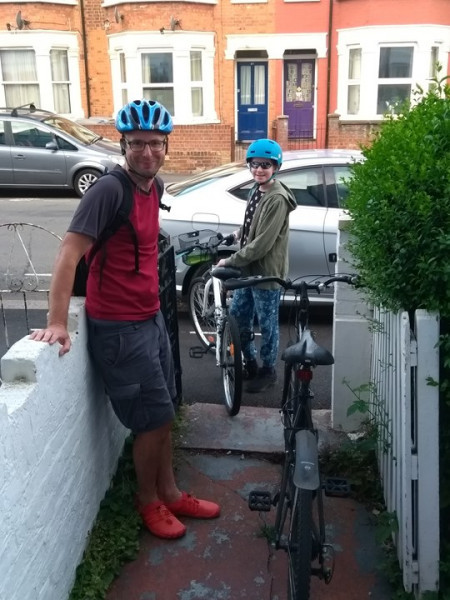 Ella and her father with their bikes, ready to cycle 30 miles to raise money for Plan UK