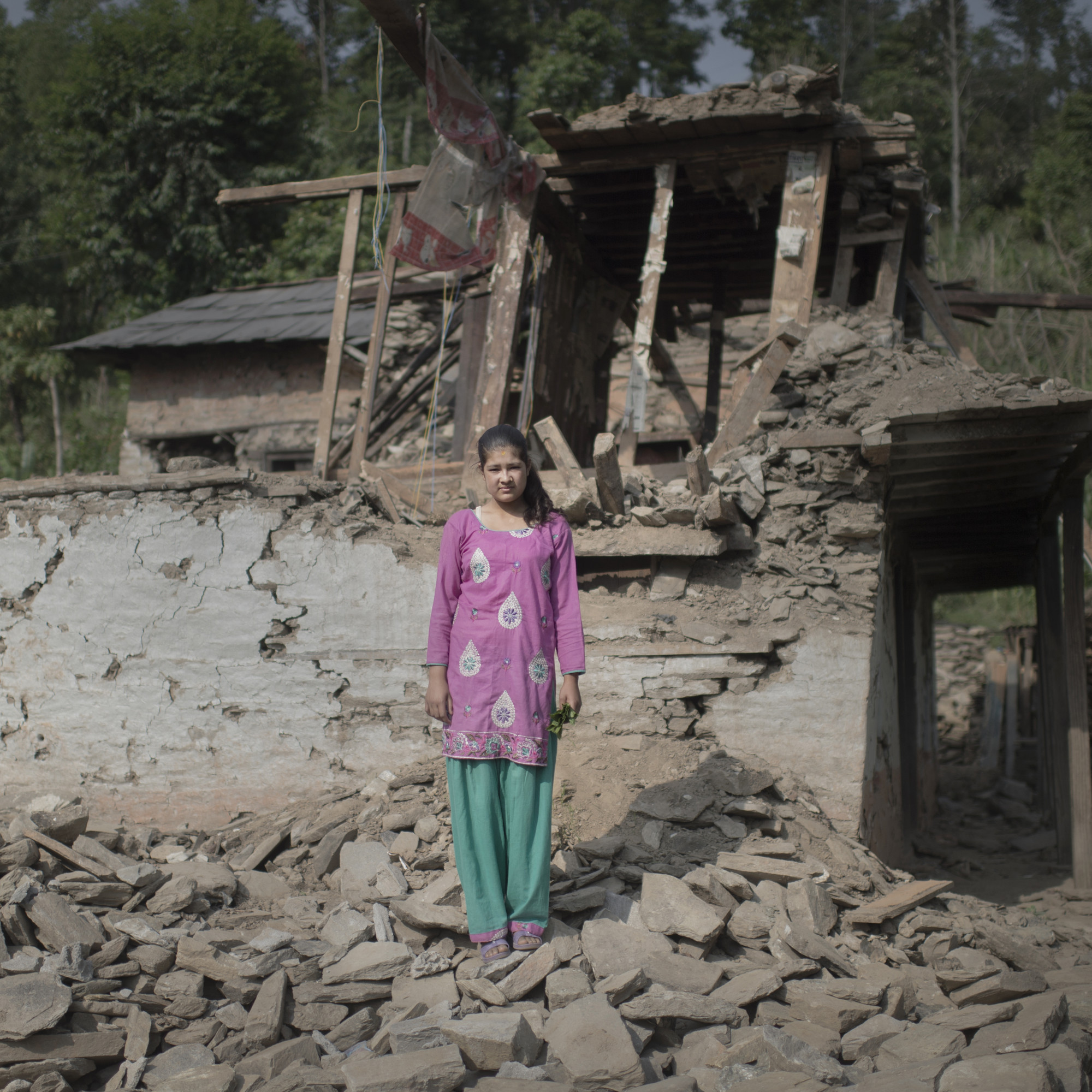 Namuna stands among rubble after the Nepal earthquakes