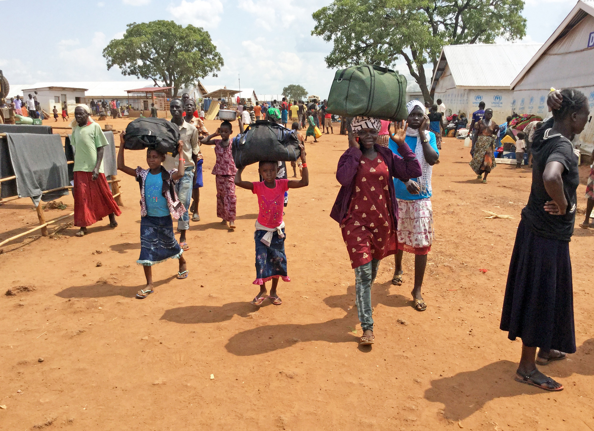 Children arriving at a Uganda refugee camp