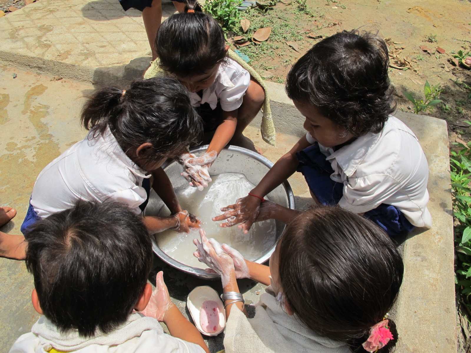 Children in Cambodia wash their hands
