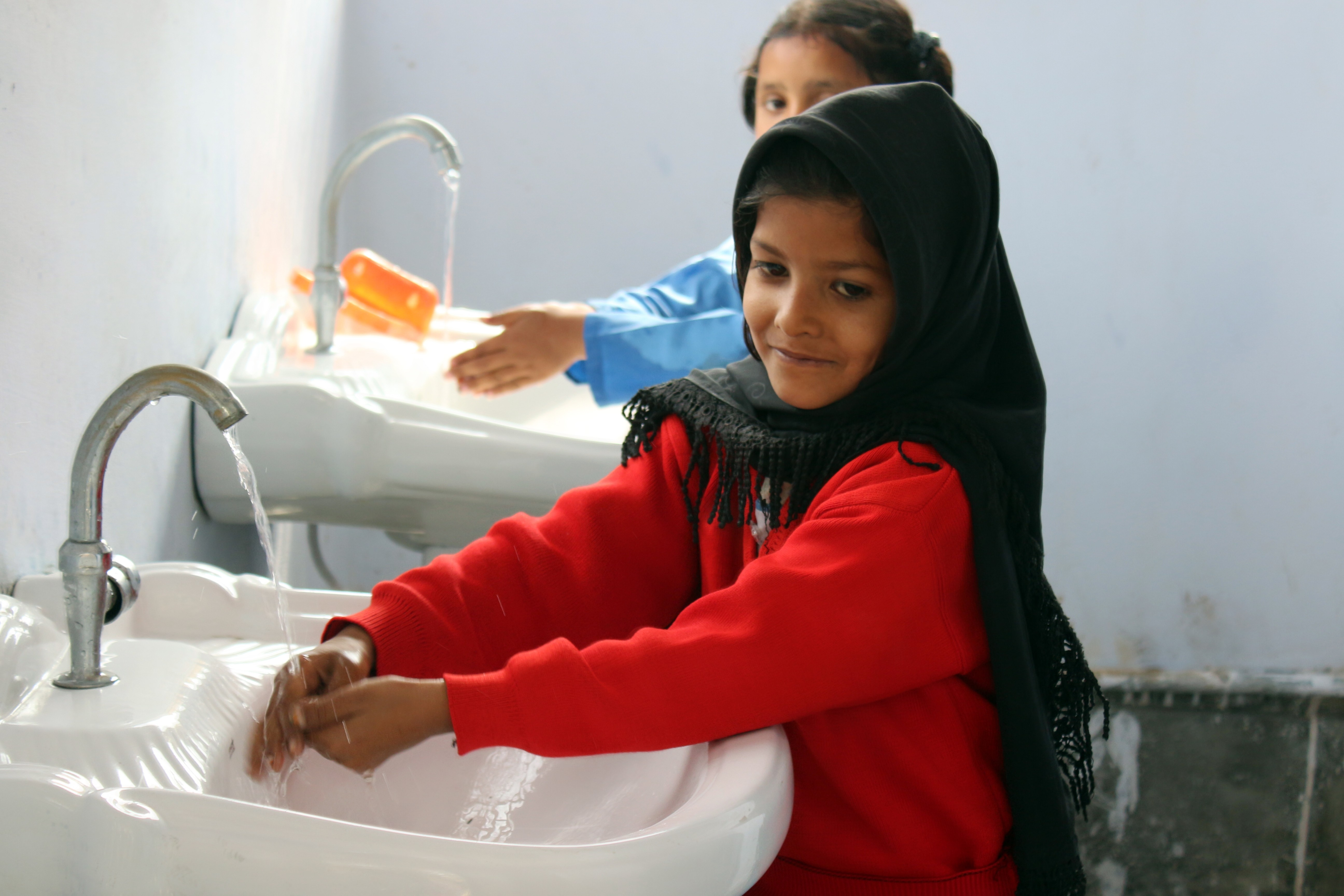 A school in Pakistan teaches children how to wash their hands