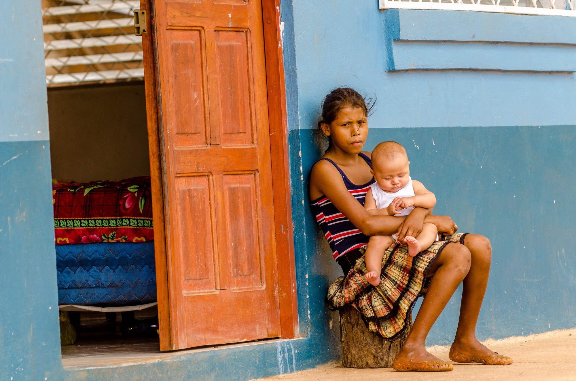A young mother sits with her child in Nicaragua