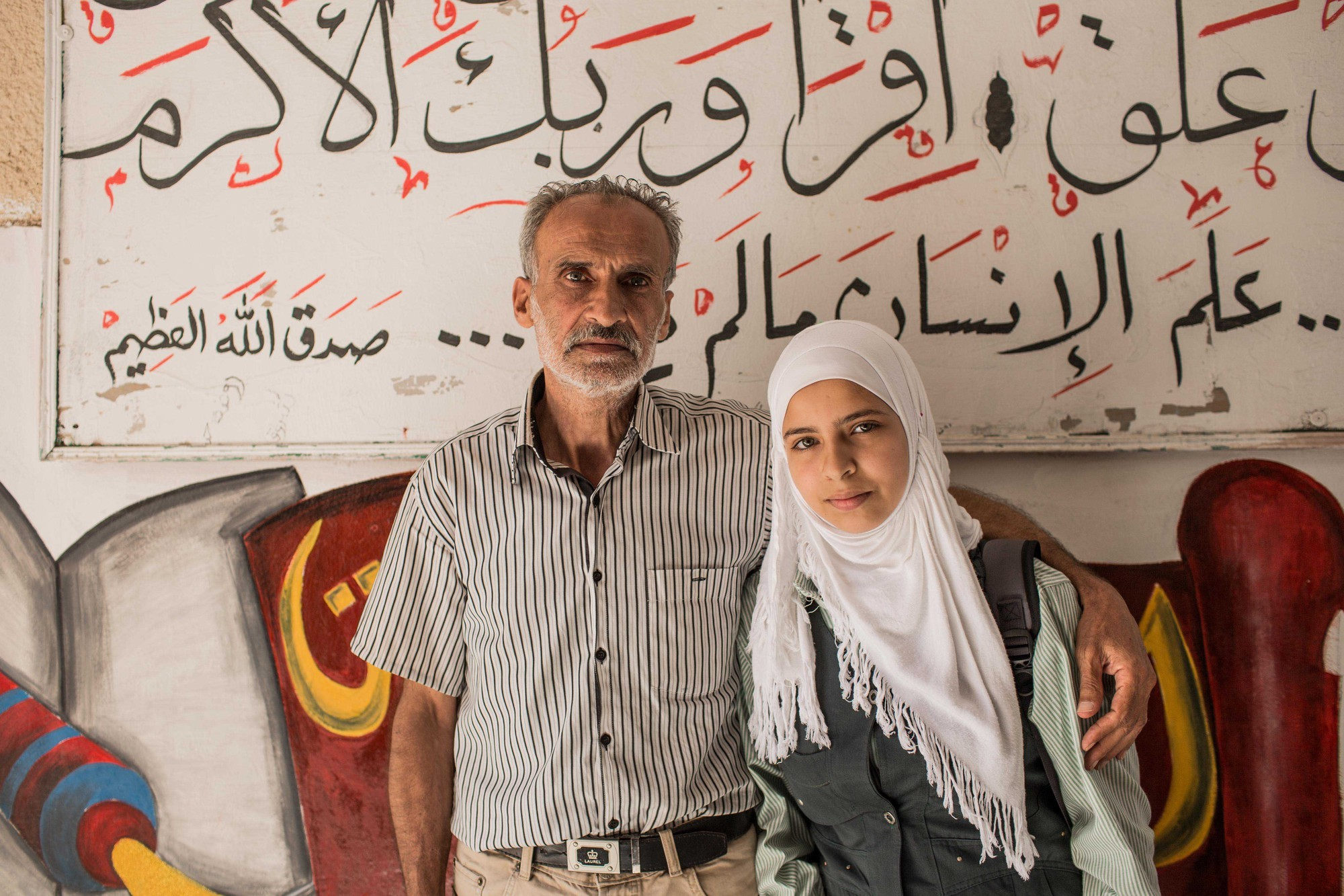 Father and his daughter who have fled Syria and are supported by Plan International in Egypt