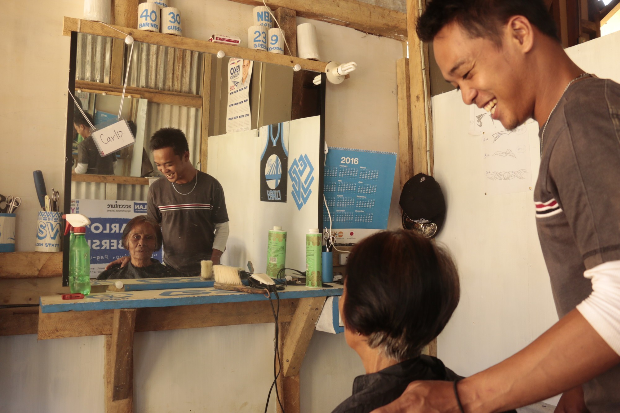 Carlo uses a Plan international grant to fund his hairdressers