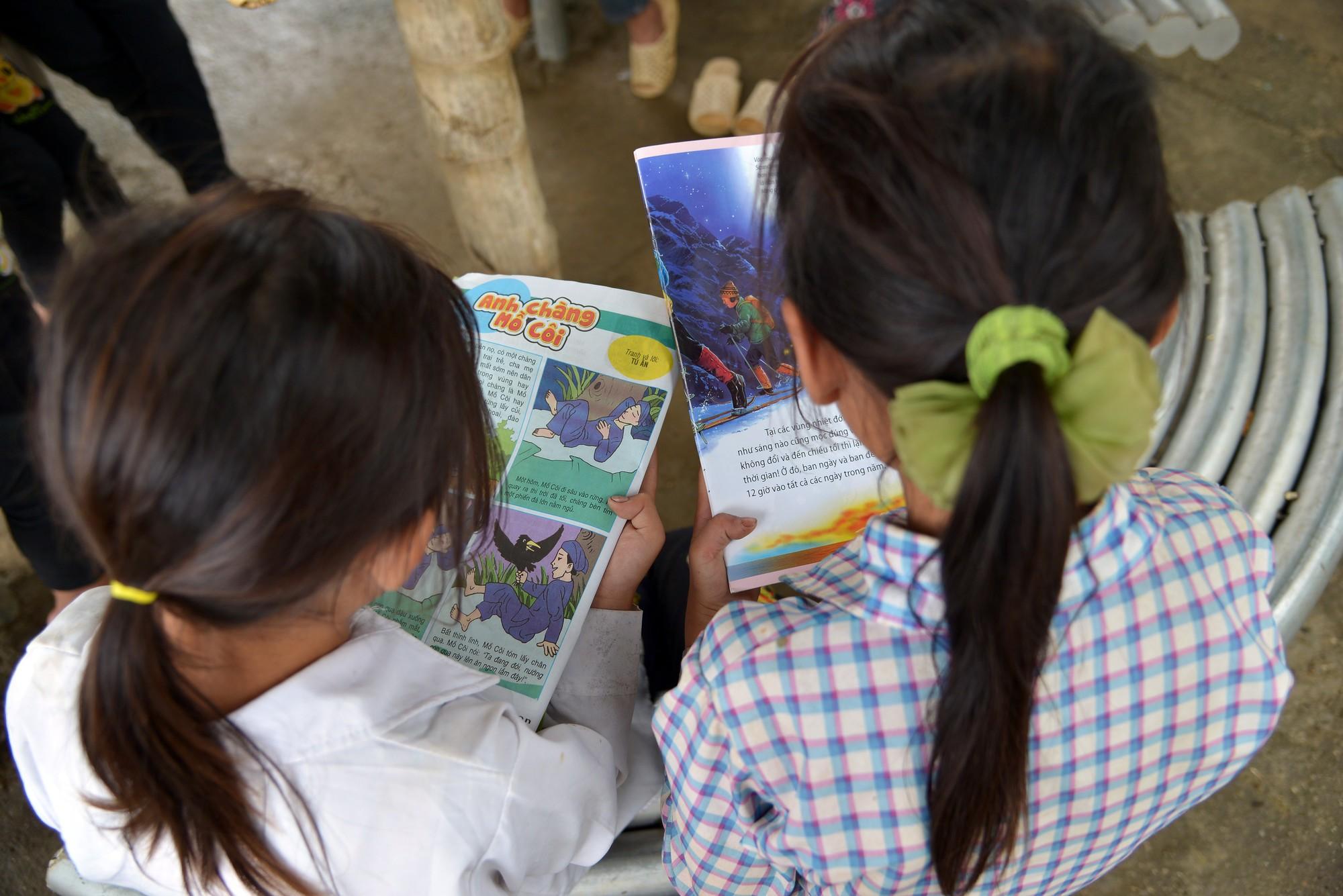 Girls reading at school in Vietnam