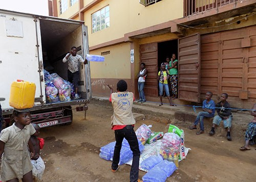Ebola programme staff receiving aid