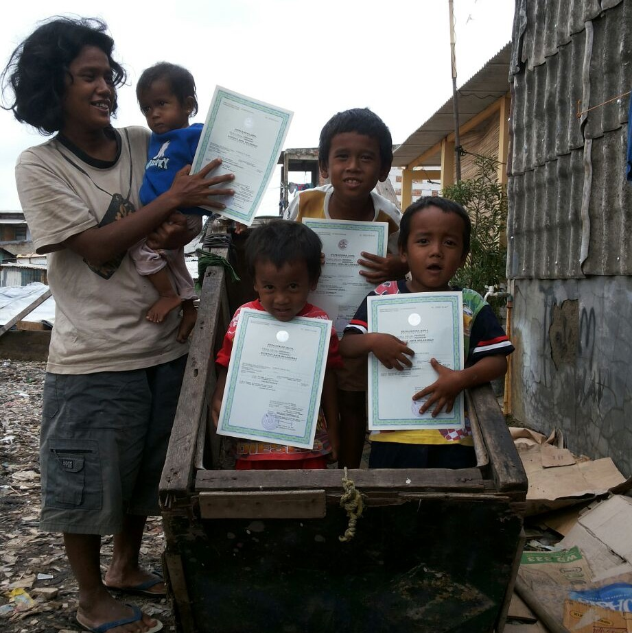 Endang with her family who have now all had their births registered thanks to Plan International