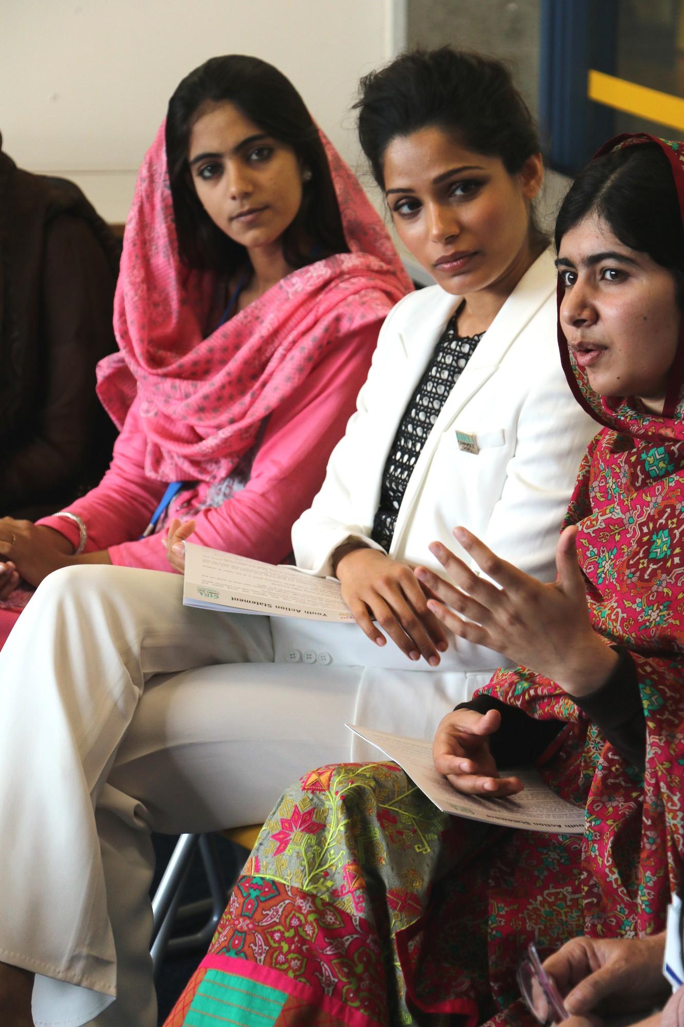 Plan Pakistan youth campaigner and Freida Pinto listen to Malala Yousafzai speak