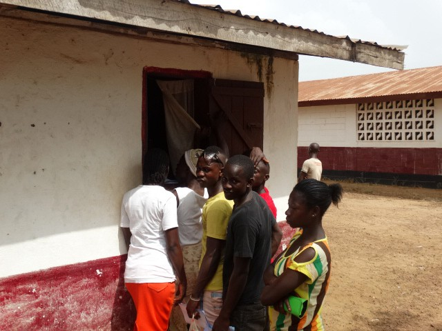 Students queue up to enrol for the new school year after Ebola