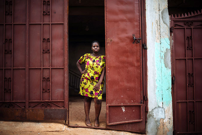 A girls stands in a doorway in Sierra Leone