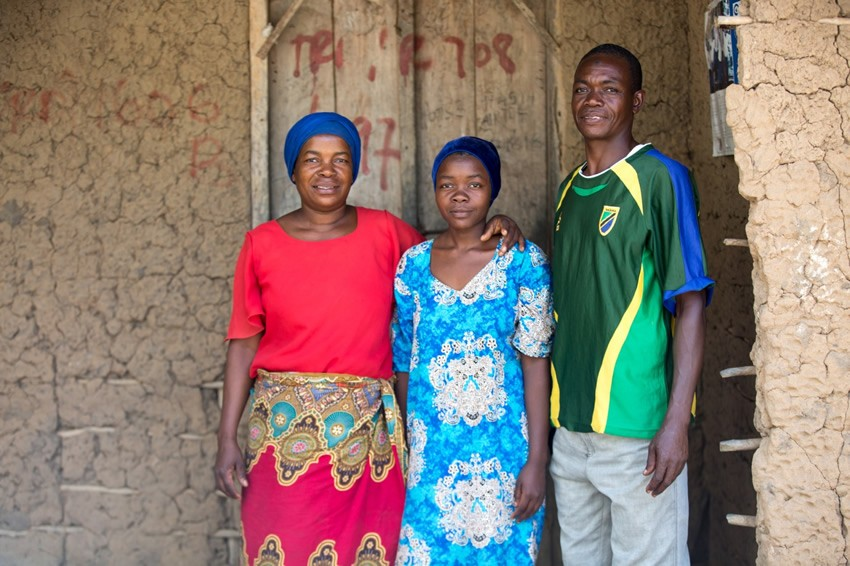 Khadija with her parents in Tanzania