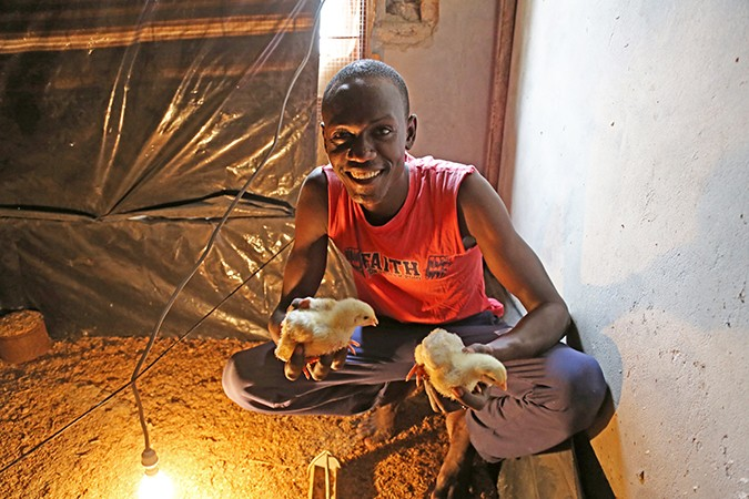 Ousmane with his chickens in Senegal