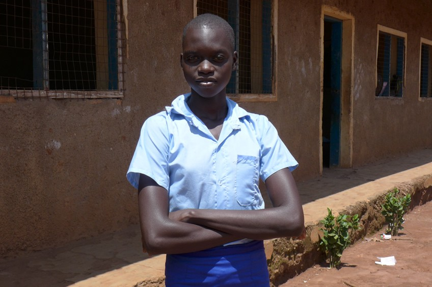 Rebecca is one of the girls who has received a dignity kit from Plan International. She married at 15 and cares for a child while continuing her education.