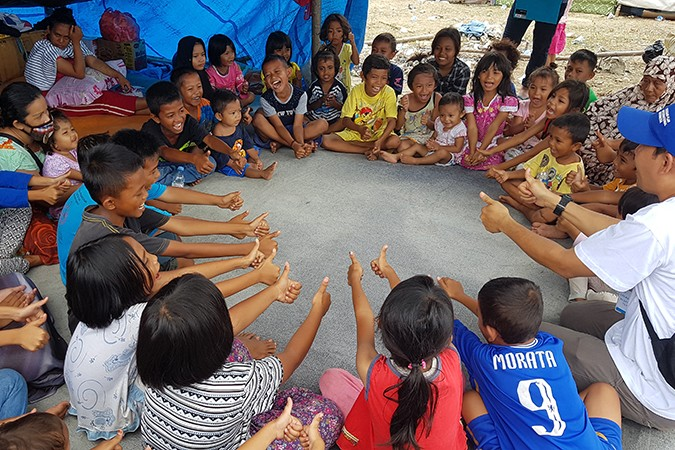 Children play in a mobile shelter in Indonesia
