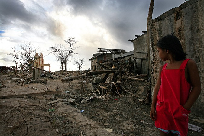 A girl in the Philippines following Typhoon Haiyan