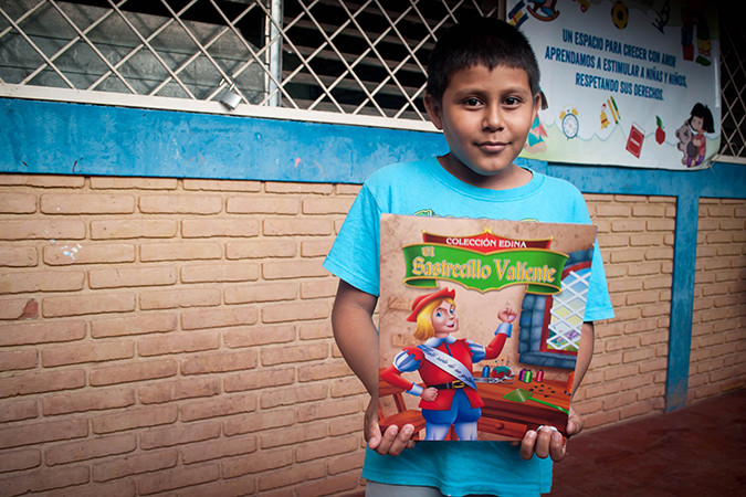Inner, 13, holds a book in Nicaragua