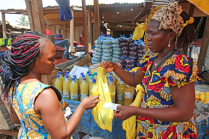 A woman exchanges vouchers for food in the Central African Republic