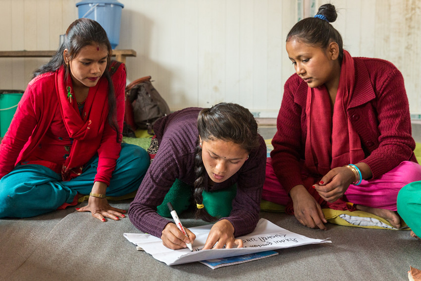 Girls take part in one of Plan's girls' clubs in Nepal