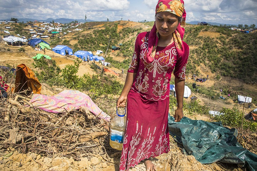 Khudeza, 14, collects water in Cox's Bazar.