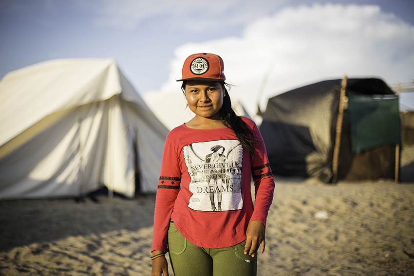 Diana, 17, is living part-time in a temporary shelter after her home in Peru was flooded.