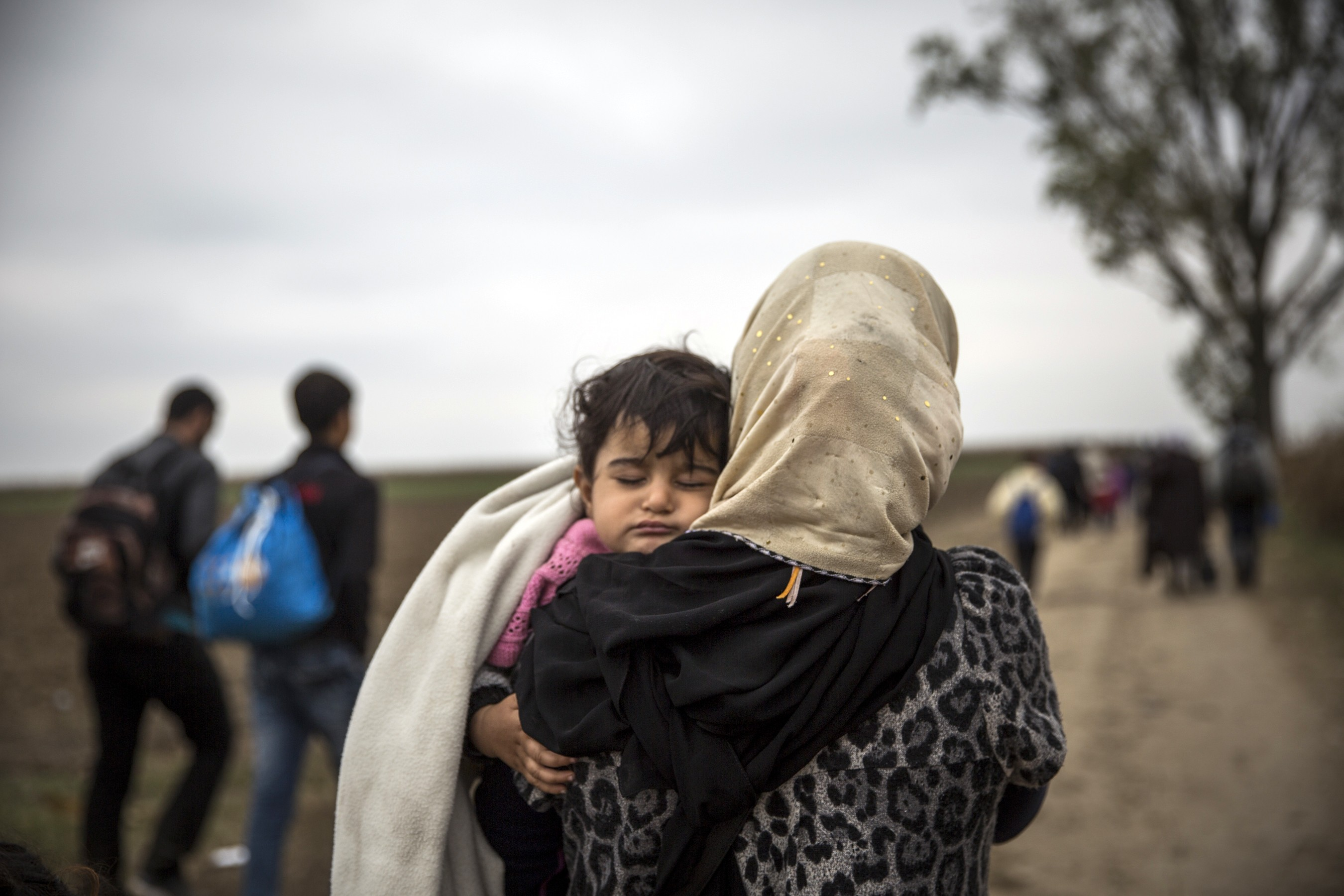 A Syrian refugee mum walks with her daughter