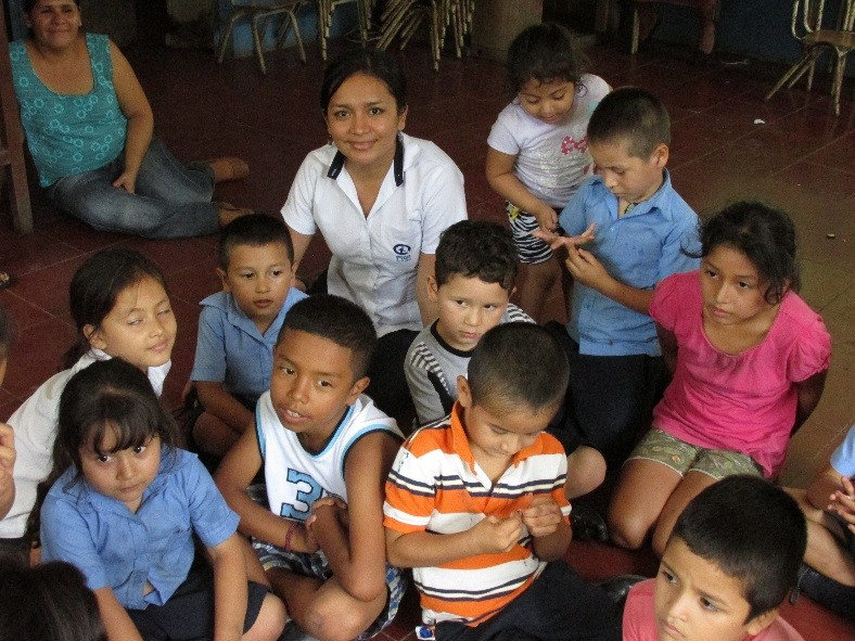 Laura with sponsored children