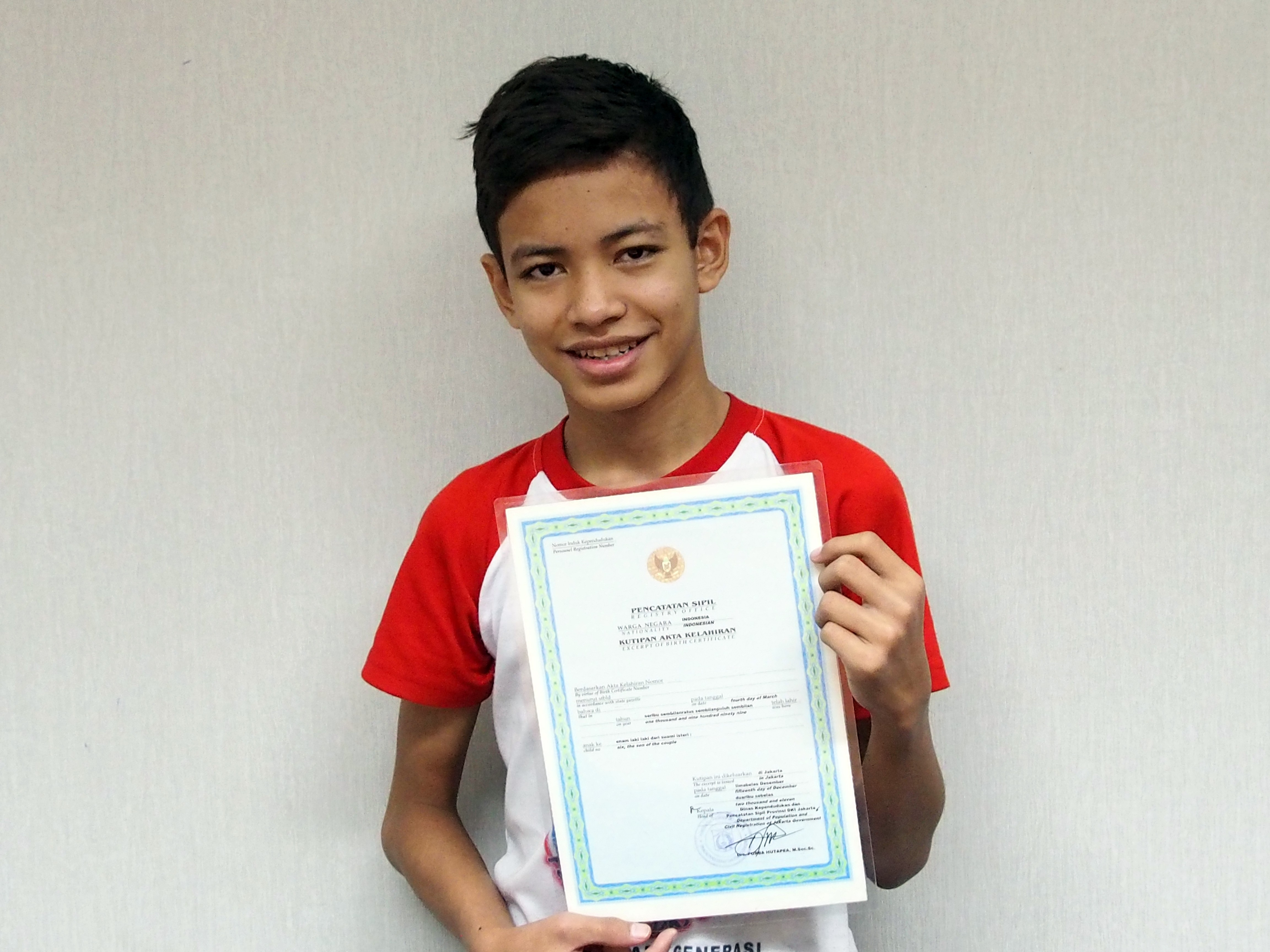 Young boy in Indonesia receives his birth certificate
